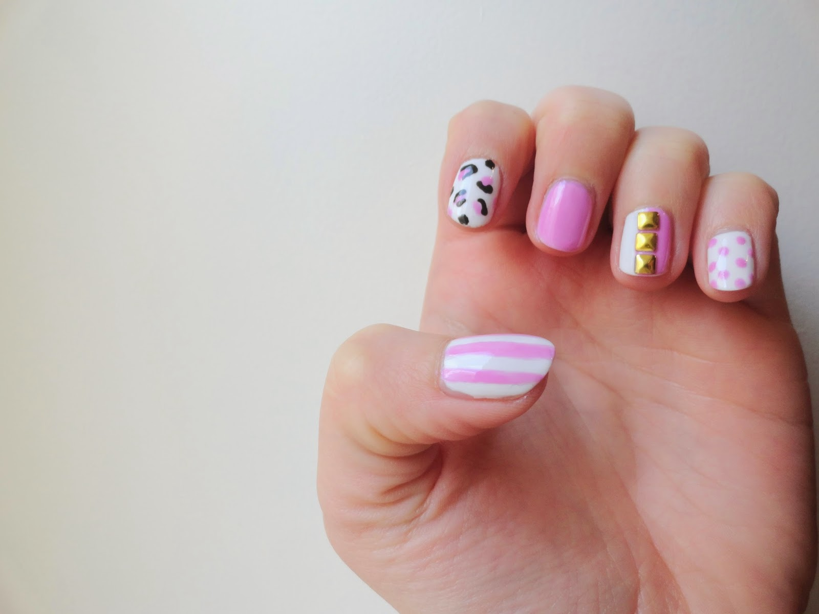 Clothes & Dreams: NOTD: All Things Pink: nail art striped pink on white, pink leopard print, pastel nail, white and pink with golden stud separator and pinks dots on white