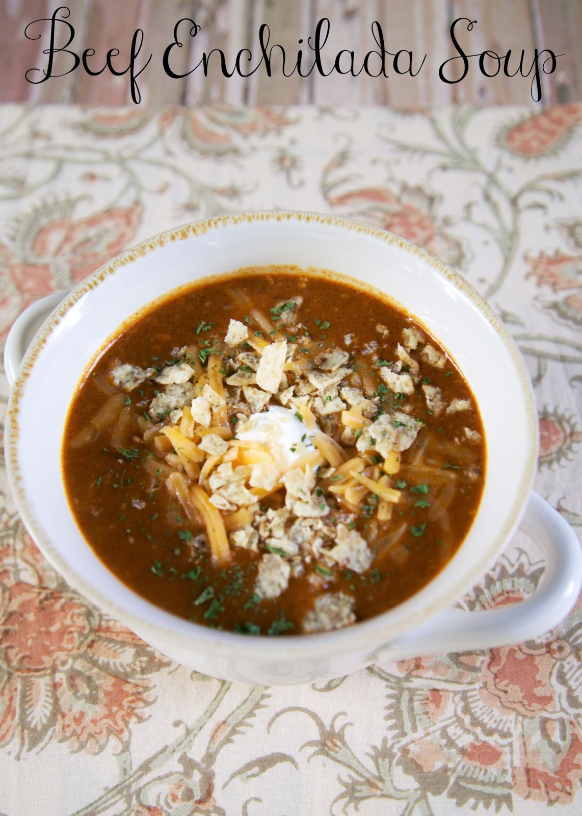 Beef Enchilada Soup made in the crock pot - so easy and tastes amazing! Stew meat, enchilada sauce, cheese soup, black beans, corn, beef broth, oregano and cheddar cheese. Throw everything in the slow cooker and dinner is done! Serve with some cornbread for an easy weeknight dinner. Can freeze and cook when ready. #soup #beef #slowcooker #crockpot #mexican #freezermeal