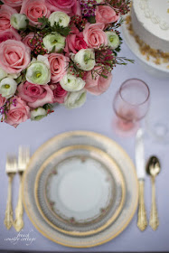 Flowers and gold china on a table