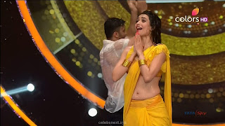 Karishma Tanna in Wet Yellow Saree on Stage Dance performence (45).jpg