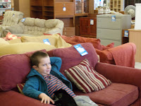relaxing on sofa in furniture shop