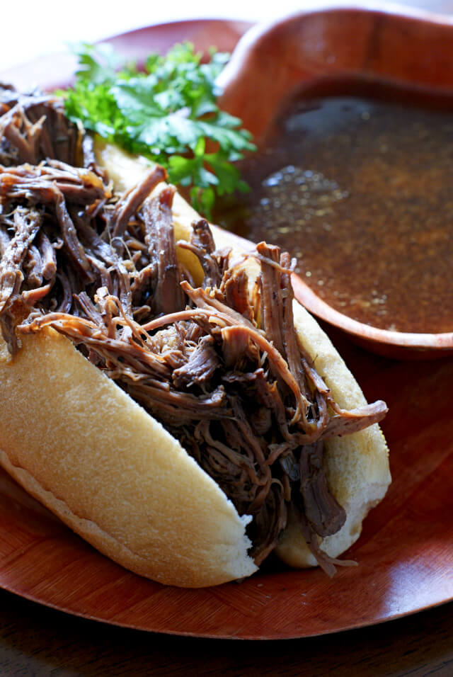 Crock Pot French Dips are super easy to make shredded beef sandwiches served alongside a rich au jus for dipping. #dinner #crockpot #frenchdip