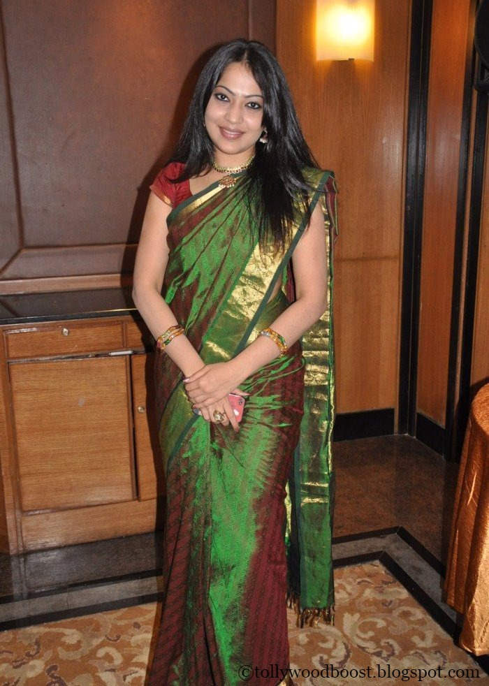 Tv Anchor Ramya Long Hair Stills In Green Saree