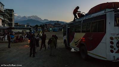 loading kayaks for the trip to Besisahar, bus kayak mountains himalayas snow WhereIsBaer.com Chris Baer