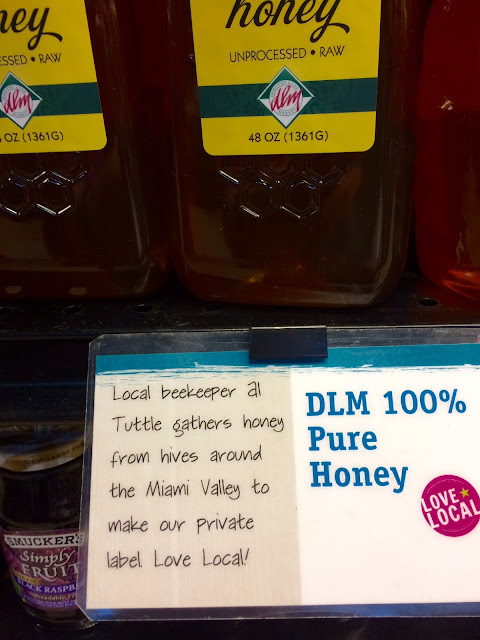 honey sold at a grocery store with local signage