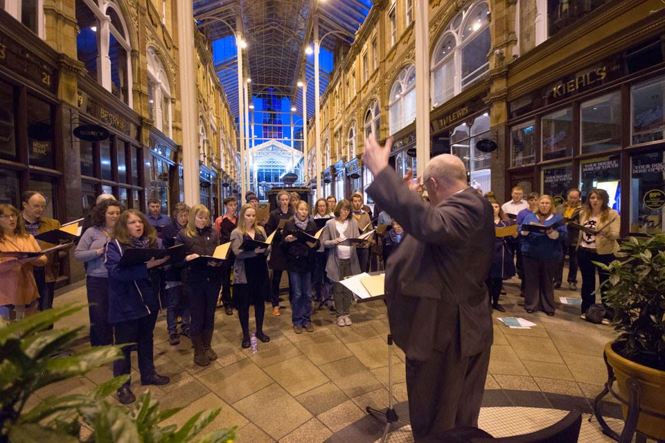 Simon Lindley conductor St Peter's Singers in the Victoria Quarter, Leeds
