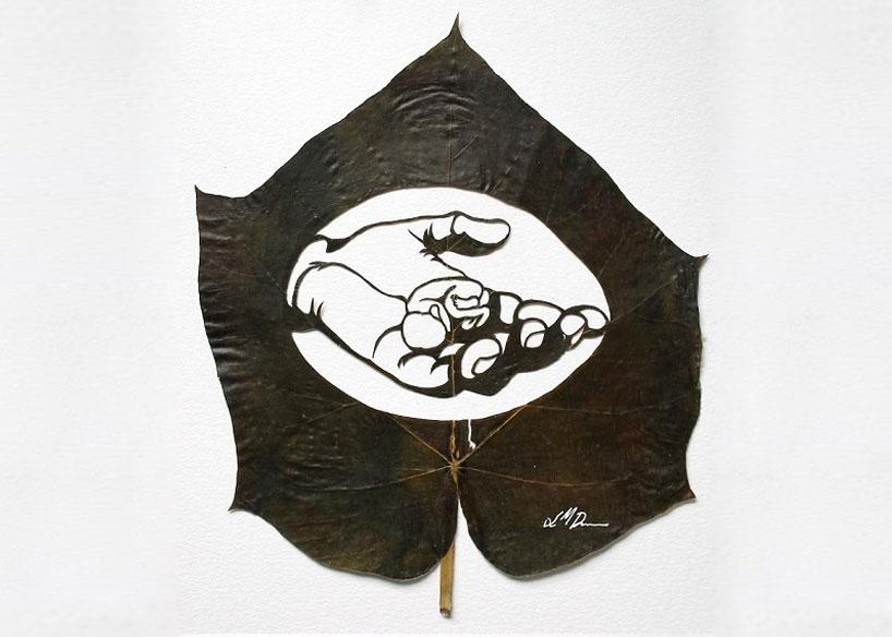 arte con hojas de árboles.