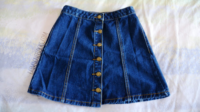 Details on the button-front denim A-line skirt from SheIn, similar to the American Apparel and Brandy Melville skirts.