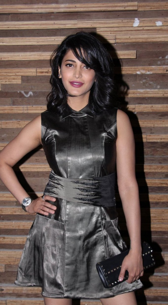 Actress Shruti Haasan Long Hair Legs Show In Black Skirt
