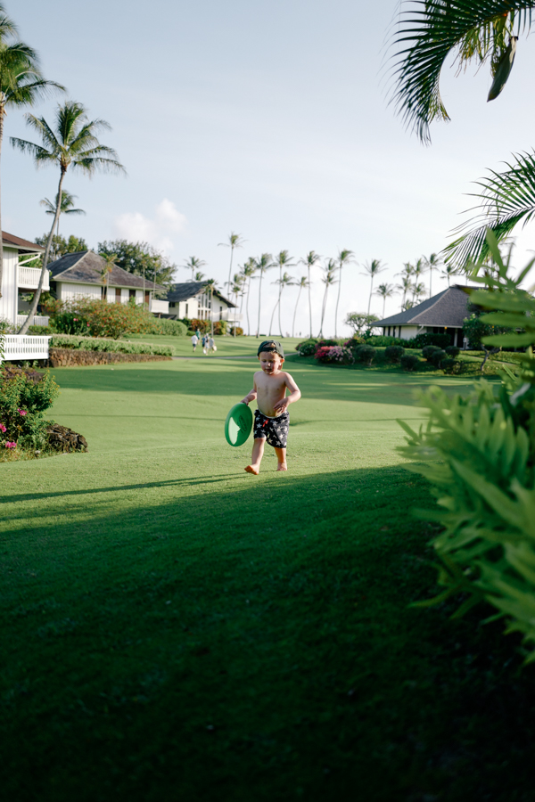 Toddler taking over the lawn at the Kiahuna Plantation, Kauai