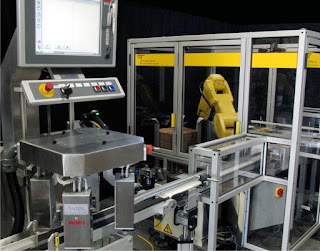Robotic case erector and loader from ESS Technologies with integrated track and trace system.