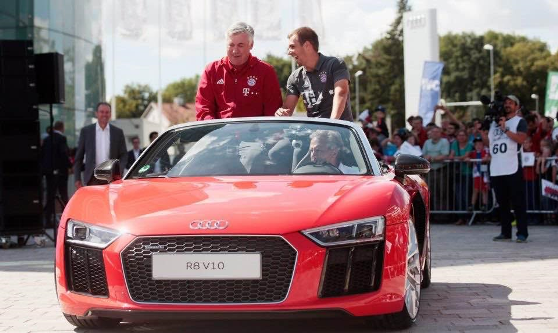 Bayern Munich players and coach Carlo Ancelotti all smiles as they get new Audi sports cars (photos)