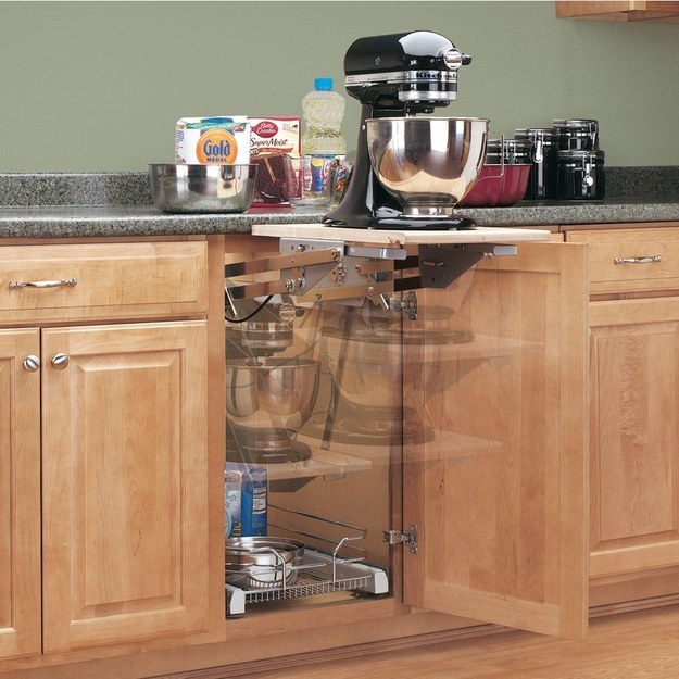 Install an appliance lift that goes right into the cabinet