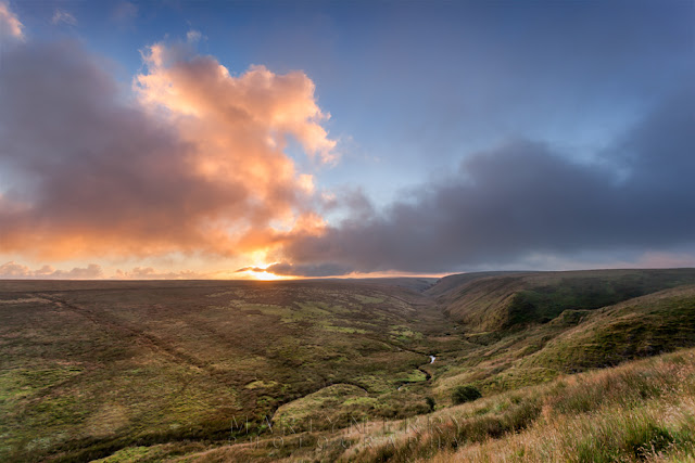 Sunrise colour in the clouds over Exmoor National Park by Martyn Ferry Photography