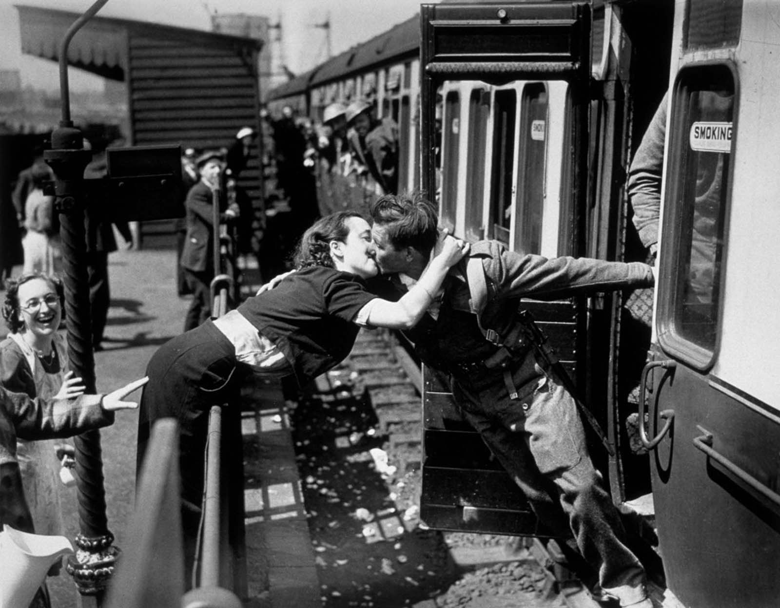 A soldier of the British Expeditionary Force is greeted by his girlfriend upon arriving back home.