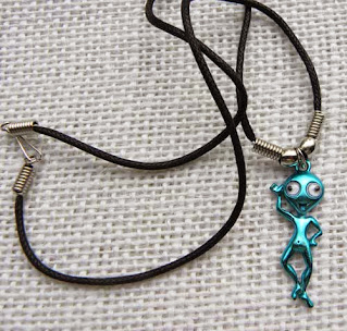 happy alien necklace