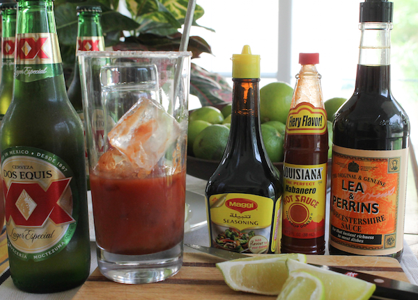 Food Lust People Love: A refreshing drink, spicy micheladas are made with cold beer, tomato juice, lime juice and lots of spicy seasonings. #SundaySupper