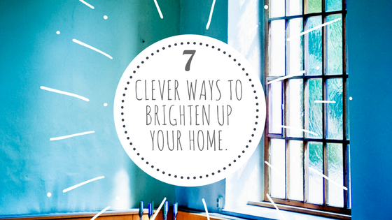 Blue walls, bright window, title '7 Clever Ways to Brighten Up Your Home.'