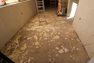 Plaster on the floor, not where it should be