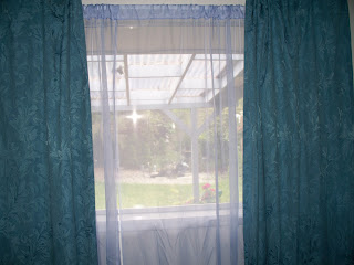 Blue curtains with violet sheer curtains