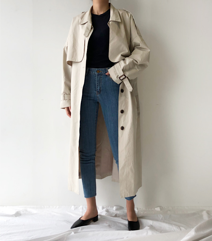 Classic Trench Coat Outfit for Spring — Death by Elocution in a Black Sweater, Raw Hem Jeans, and Black Mule Heels