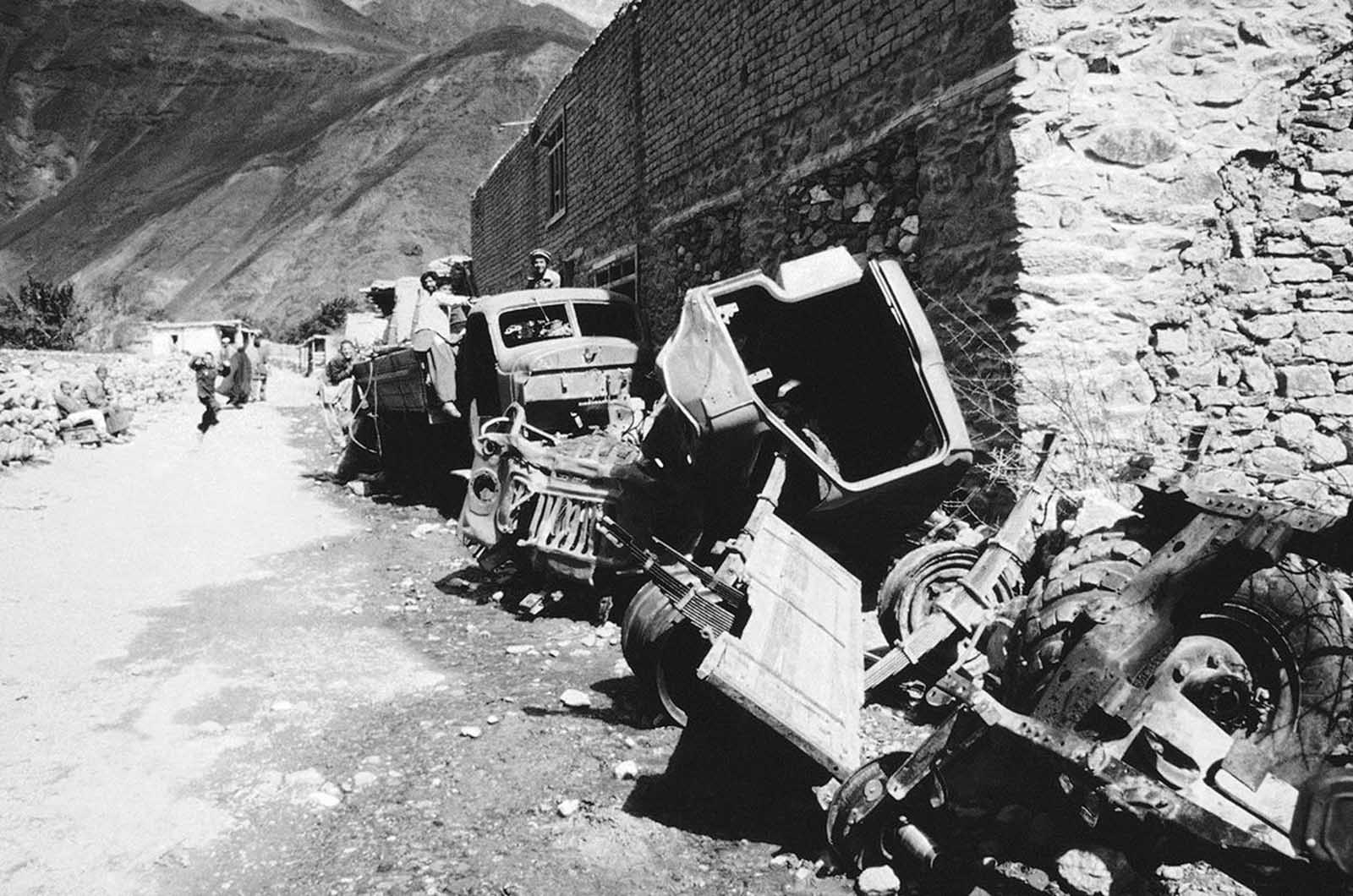 Wrecked Soviet vehicles are shoved alongside the street in the Panchir Valley village of Omarz in northeast Pakistan in February of 1984.