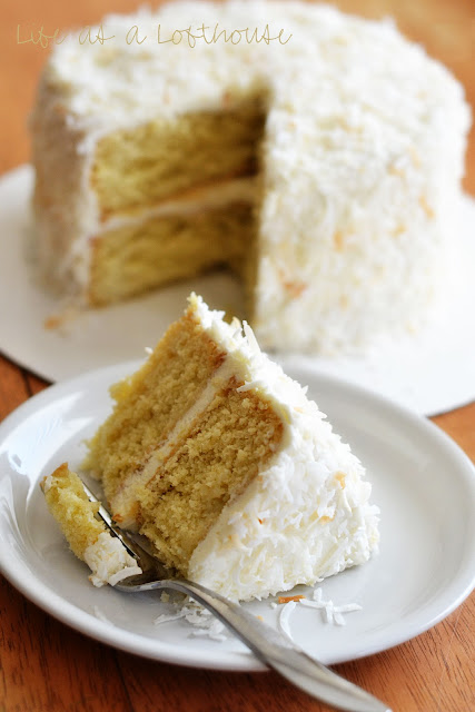 This Coconut Cream Cake with Cream Cheese Frosting is a delicious, moist cake with two cake layers covered in a silky smooth frosting. Life-in-the-Lofthouse.com