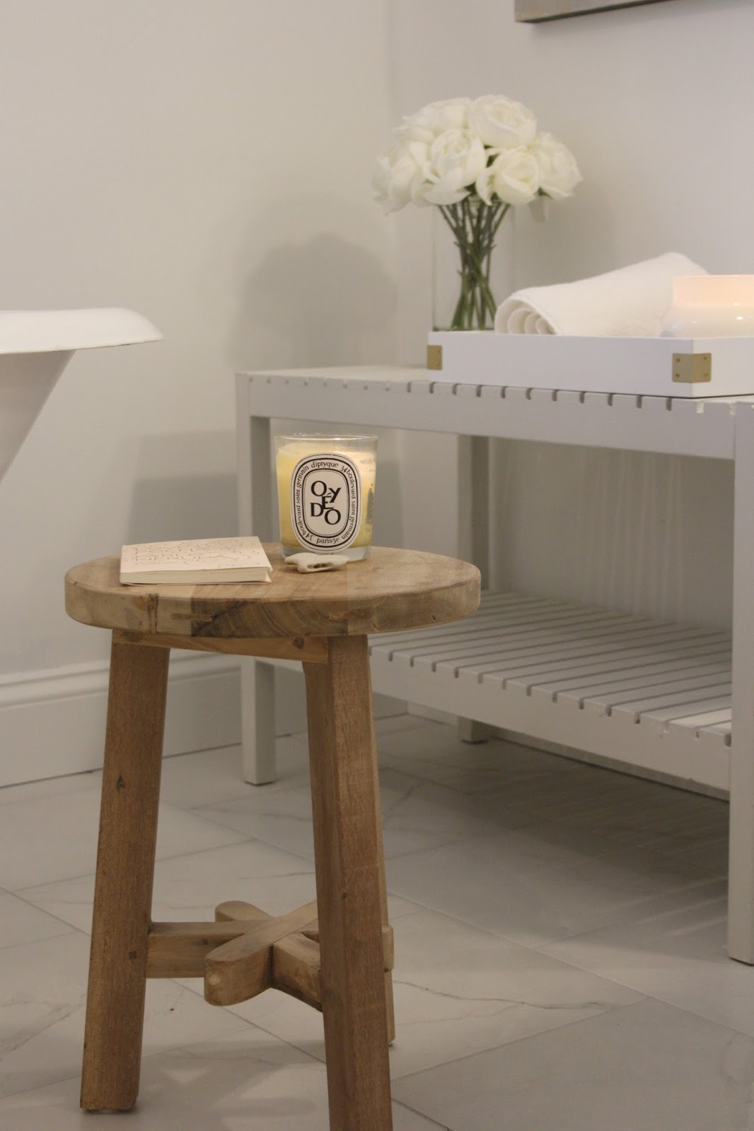 Rustic three leg teak stool in modern farmhouse style bathroom by Hello Lovely Studio
