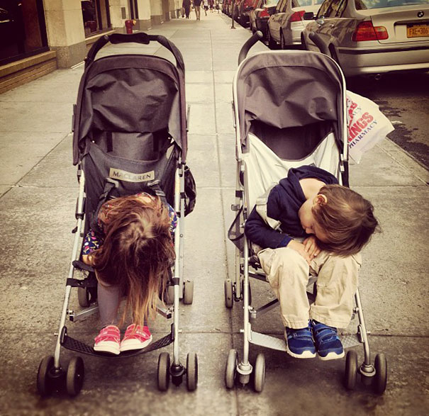 15+ Hilarious Pics That Prove Kids Can Sleep Anywhere - Napping In A Stroller