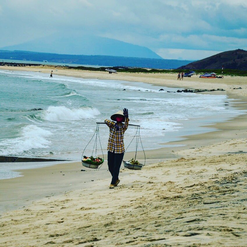 locals at mui ne beach in Vietnam
