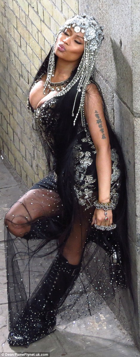 Nicki Minaj Stuns In Bejeweled Outfit For Music video Shoot