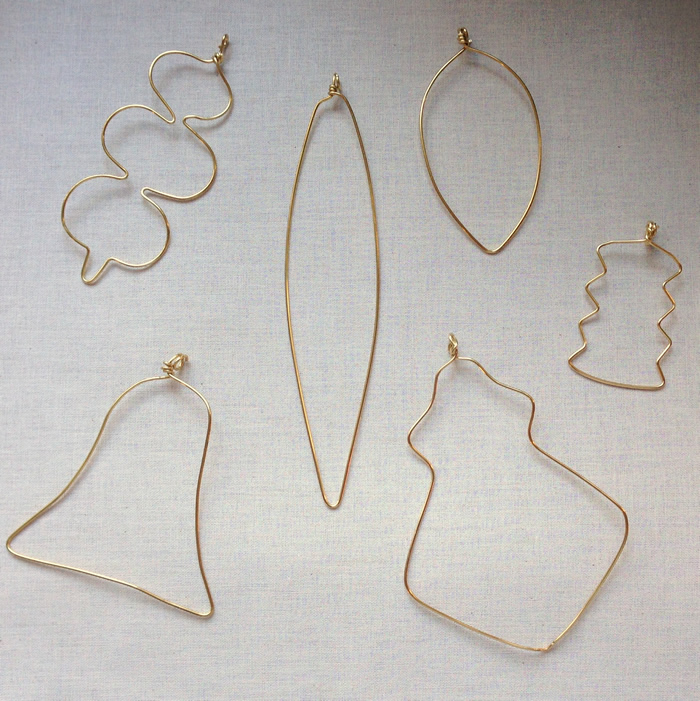 Make wire ornaments with this easy DIY - fill in with beads.  From Lisa Yang's Jewelry Blog
