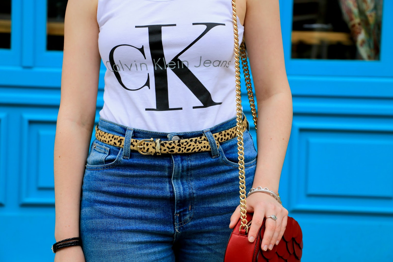 NYC fashion blogger Kathleen Harper wearing leopard belt with high-waisted jeans