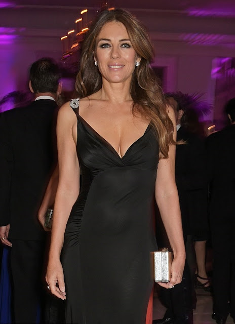Elizabeth Hurley shows off her sensational curves in plunging black gown