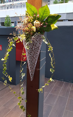 Bloem provided all the flower arrangements for the celebration, including these wall arrangements.