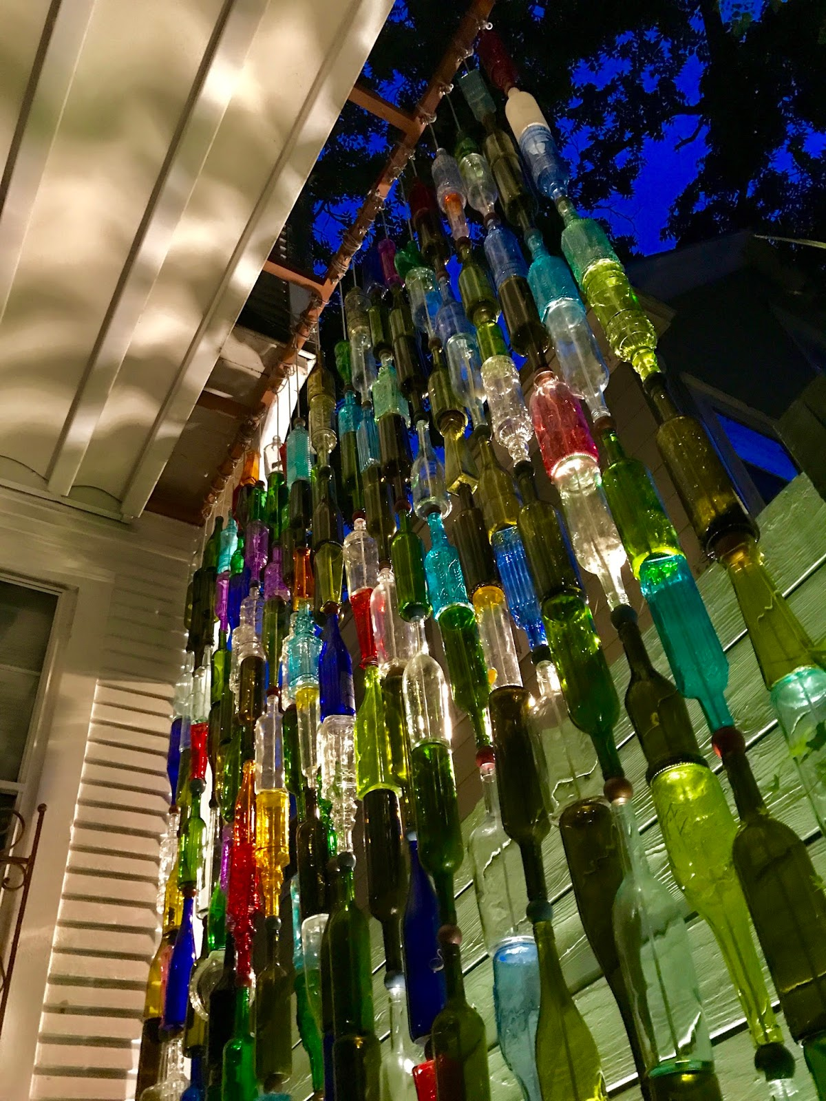 Garden art - a brilliant wine bottle wall