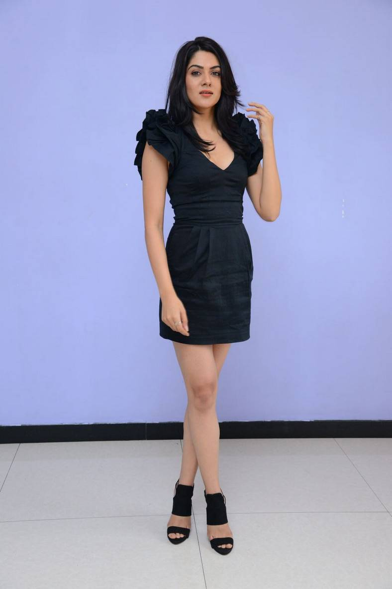Sakshi Chaudhary Legs Show Photos At Movie Trailer Launch In Black Dress