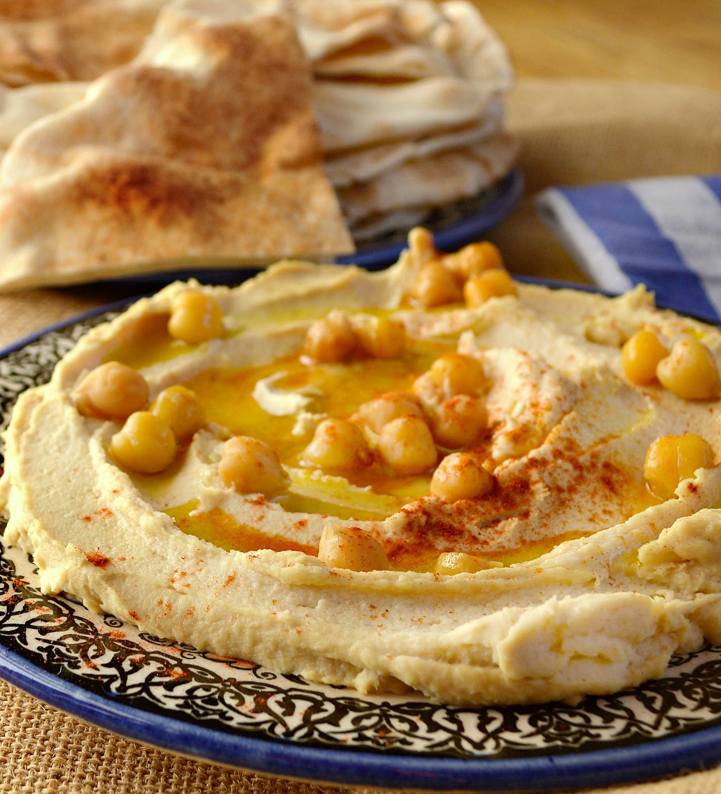 This is REAL HUMMUS. It is made from dried chickpeas. It is addictive and delicious. It converts hummus haters. It spreads like frosting and is silky smooth. It might even be better than frosting. www.thisishowicook.com #hummus #appetizer