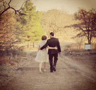 wedding couple  walking down the road embracing