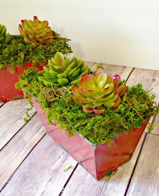 Ashley from 3 Little Greenwoods shares a great project for planting faux succulents so they look real!