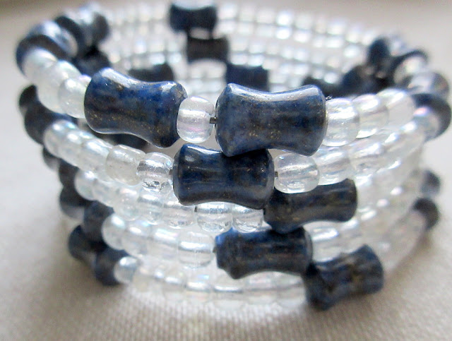 Sciart mathart bracelet featuring the digits of pi in glass and lapis lazuli. Perfect gift for math teachers and students.
