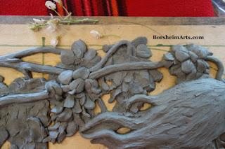 Starting to model wisteria in bas-relief sculpture Borsheim Art