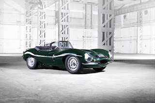 A picture of a green Jaguar open top sports car