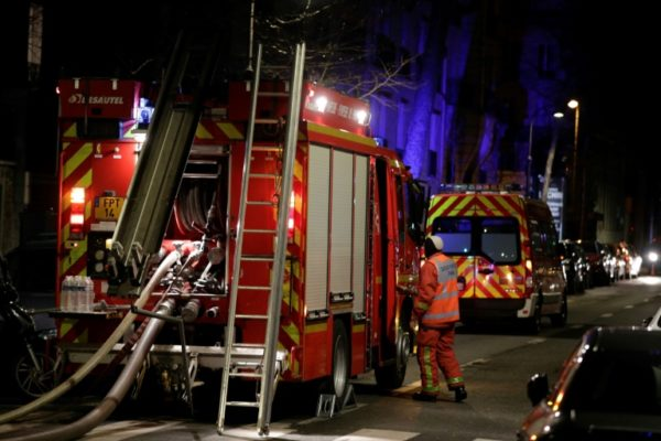 Fire fighters at the scene of Paris building blaze