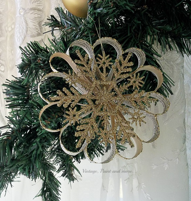 Vintage, Paint and more... a vintage snowflake ornament diy'd using book pages, glitter and gold snowflakes