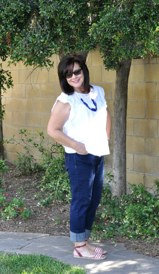 blue jeans, white blouse and red and white striped espadrilles