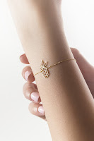 14k yellow gold pineapple bracelet with tiny white diamond