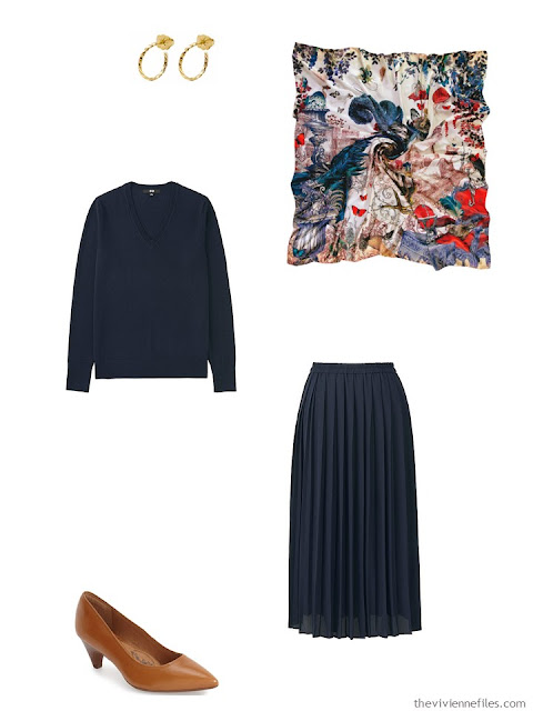 navy sweater and skirt with brown pumps, gold earrings and a silk scarf