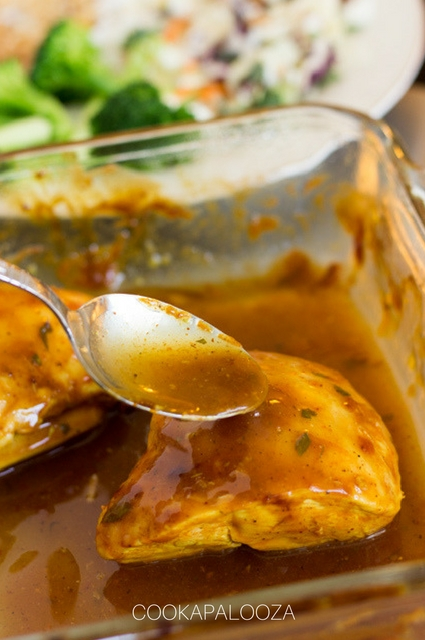 Spooning Sauce Over Baked Barbecue Chicken in Baking Dish