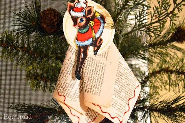 Holiday recycled book ornament on a tree